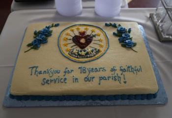he decorative cake honoring the sisters' service, specially designed with the IHM logo. . (Photo courtesy Sister Teresa Ballisty)
