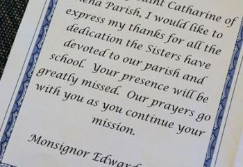 Msgr. Edward Domin's words of thanks to the sisters on behalf of the parish in the Mass program. . (Photo courtesy Sister Teresa Ballisty)