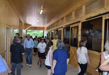 Supporters tour the first floor of the stable that features seven stalls. (Photo by John Simitz)