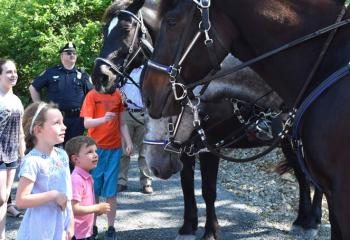 Children visit with the police horses at the facility. (Photo by John Simitz)
