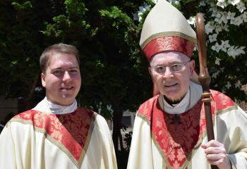 Father Rother, left, with Bishop Cullen after his ordination. (Photo by John Simitz)