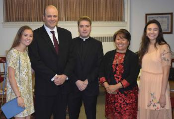Father John Rother, center, is joined by his immediate family before his ordination, from left, his sister Gracia, his father John, his mother MarySue and his sister Melinda. (Photo by John Simitz)