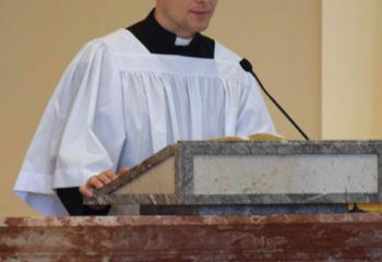 Giuseppe Esposito, diocesan seminarian, offers the First Reading. (Photo by John Simitz)