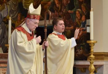 Father Rother, right, bestows the final blessing with Bishop Cullen at the conclusion of the Rite of Ordination to the Priesthood. (Photo by John Simitz)