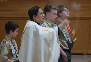 Father Eric Tolentino at the benediction of the Blessed Sacrament. (Photo by John Simitz)