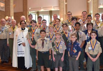 Gathering at the ceremony are, from left: front, Sebastian Malaver, Evan Houser, Benjamin Mickulik and Liam Damitz; second row, Father Eric Tolentino, Stephen Beck III, Conor Christ, William Mickulik, Supreeth Dmello and Joanne Loeper; third row, Bill Brodniak, Fred Flemming, Nathan Wilson, Christopher Trubilla, Robert Hudopohl, Rhaife Combs and Todd McGreggor; back, Bill Minford, Bernard Hofmann, Brendan Christ, Christian Dunlap, Christopher Kochel, Keith Nedidig, Ed Miller and Seamus McGee.