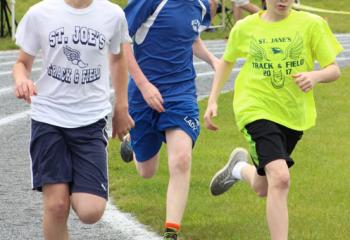 Runners from St. Joseph the Worker, Orefield; Our Lady of Perpetual Help (OLPH), Bethlehem; and St. Jane Frances de Chantal, Easton compete May 20 in the Diocesan Catholic Youth Organization (CYO) Track and Field Meet. OLPH placed first at the event with 138 points.