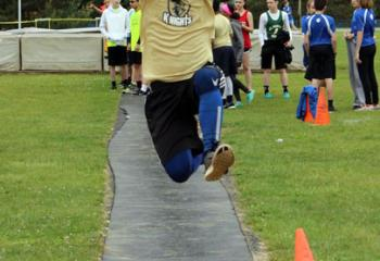 Brady White, Notre Dame of Bethlehem, leaps off the takeoff board during the long jump event at the meet.