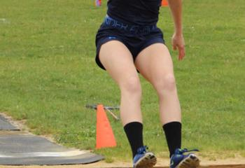 Carissa Peck, Holy Family, Nazareth, executes the long jump and clinches first place in the event.