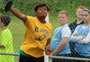 Madison Moore, St. Joseph Regional Academy, Jim Thorpe, throws the discus.