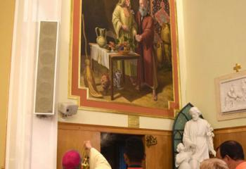 Bishop-elect Alfred Schlert incenses the mural featuring St. Anne and St. Joachim.