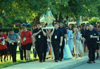 Msgr. David James, right, joins in the Rosary Procession. (Photo by John Simitz)