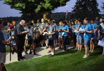 Msgr. David James leads the July 19 outdoor Stations of the Cross. (Photo by John Simitz)