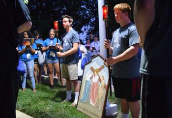 Campers pray at the station where Jesus meets his Blessed Mother. (Photo by John Simitz)