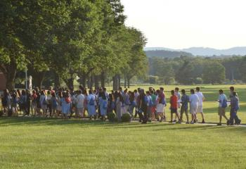 Campers, clergy and religious sisters join in the Rosary Procession. (Photo by John Simitz)