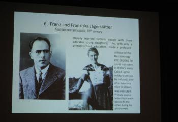 A slide displays Franz and Franziska Jägerstätter, a happily married couple who criticized Nazi ideology. Franz was executed and declared a martyr in June 2007 and beatified in October 2007.