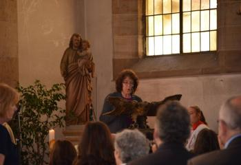 Marian Gehringer, parishioner of MBS, reads the first reading during Mass at SS. Peter and Paul.