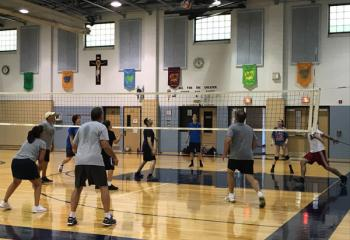 A recent game of recreational volleyball serves up a chance for fun and fellowship at St. Ignatius Loyola. (Photos courtesy Father Stephan Isaac)