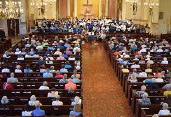 "More than 500 faithful enjoy the Combined Choirs' performance of ""As I Kneel Before You"" by James Kilbane."
