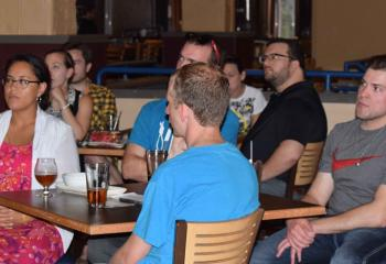 Young adults listen to Guman's presentation, which wrapped up the summer session of Theology on Tap, sponsored by the diocesan Office of Youth, Young Adult and Family Ministry.