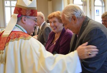 Bishop of Allentown Alfred Schlert, left, congratulates Justine and Andrew Wesnak for celebrating 60 years of marriage.