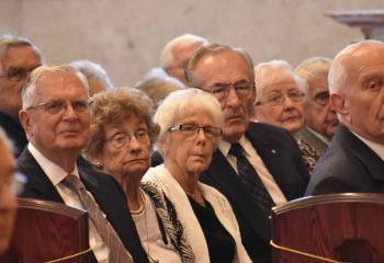 Married couples listen to the homily during the Mass.