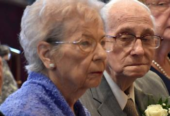 Joseph and Hila Schedler participate in the Mass in celebration of 70 years of their marital union.