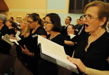 Members of the Combined Choir from parishes in the Northampton Deanery sing a hymn during Mass. More than 90 choir members joined together to perform musical selections at the first of five deanery Masses to be celebrated by Bishop Schlert.