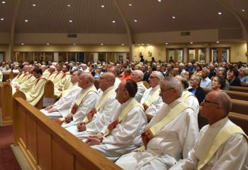 Clergy and laity attend the evening Mass.