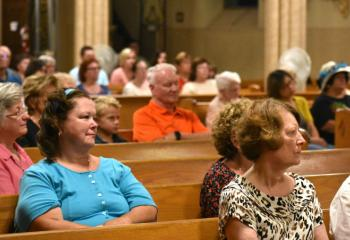 Faithful from Carbon County listen to Bishop Alfred Schlert's homily.