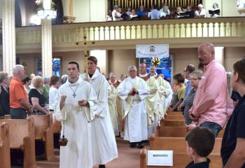 Clergy process into the evening liturgy.