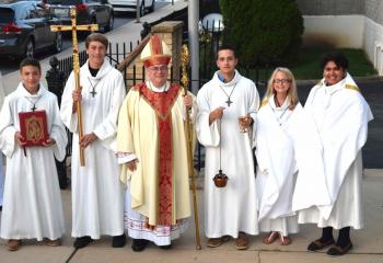 Bishop Alfred Schlert, center, is greeted by altar servers, from left: Anthony Soberick, Immaculate Conception, Jim Thorpe; Noah Snisky, St. Joseph, Jim Thorpe; Zach Mauro, St. Peter the Fisherman, Lake Harmony; Brianna Snisky, St. Joseph; and Rianna Mohammed, St. Peter the Fisherman.