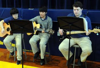 Guitarists of Notre Dame's Music Ministry are, from left, Yunji Sun, Dongseop Lee and Chris Bianchi. (Photo by Ed Koskey)