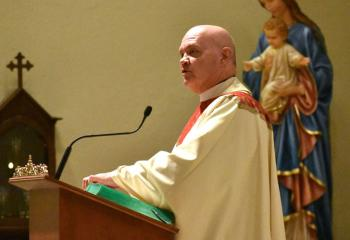 Msgr. Daniel Yenushosky thanks Bishop Schlert for his presence with the faithful that evening.