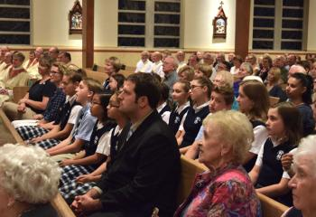 Clergy, laity and students participate at the Mass.