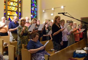 Saint Francis' Parish Choir beautifies the liturgy with song.