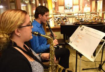 Musicians, Sarah Wascavage and Ben Miller, parishioners of St. Francis of Assisi, enhance the music for the Mass.