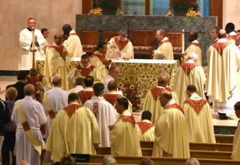 Priests receiving communion.