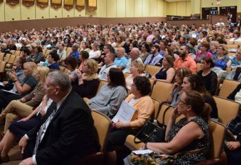 "An estimated 1,000 educators for the Diocesan Catholic schools listen during the convention ""All are Welcome in Christ."""