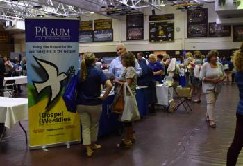 Educators tour the more than 50 exhibits and vendors in the school gymnasium.