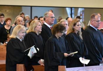Judges attend the noon liturgy, from left: front, Judge Eleni Dimitriou Geishauser, Judge M. Theresa Johnson and Judge Emil Giordano; back, Magisterial District Judge Gail Greth, Judge Madelyn Fudeman, Bankruptcy Judge Richard Fehling and Judge Thomas Parisi.
