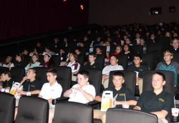 Movie snacks in hand, students of Good Shepherd Catholic School, Northampton are ready for the movie to begin.