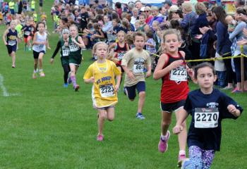 Kindergarten girls run during the meet.