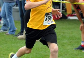 Chase Eller of St. Theresa of the Child Jesus, Hellertown is the first of the fifth- and sixth-grade boys to reach the finish.