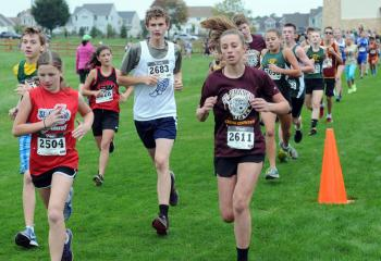 Seventh- and eighth-grade boys and girls run at the meet.
