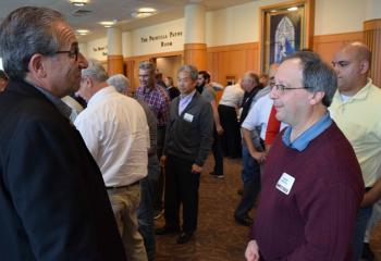 Speaker Marty Rotella, left, talks with Vincent Santvcci, parishioner of Assumption BVM, Northampton, during one of the conference breaks.