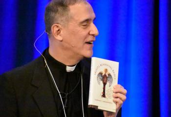 "Father Ezaki suggests the book ""Saints Behaving Badly"" to men participating in the conference."