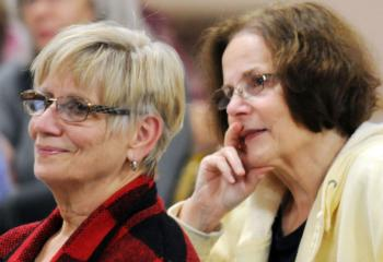 Rita Hocking, left, and Maureen Bozzuto listen during the discussion focusing on Marian prayers and the mysteries of the rosary.