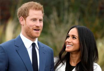Britain's Prince Harry poses with Meghan Markle Nov. 27 in the Sunken Garden of Kensington Palace in London after announcing their engagement. Markle attended Immaculate Heart High School in Los Angeles. (CNS photo/Toby Melville, Reuters)