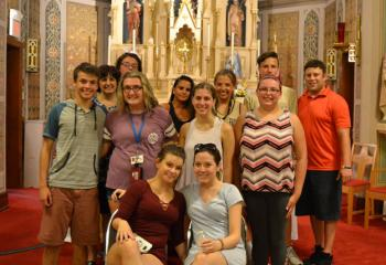Teens from Our Lady of Mount Carmel and Queenship of Mary gather for a group photo with their youth ministers. (Photo by Alexa Doncsecz)